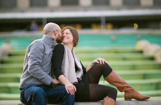engaged couple laughing in front of cincinnati museum center