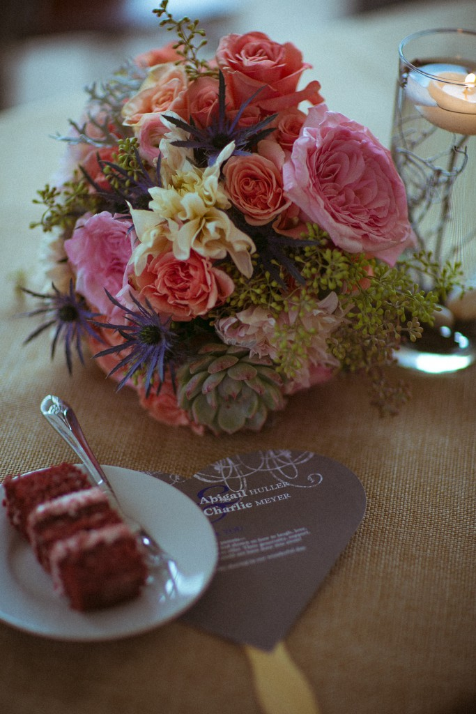 wedding bouquet and cake detail photo