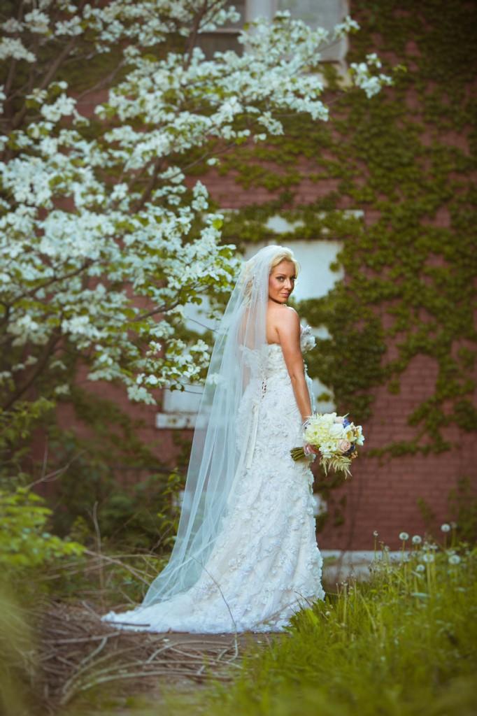 bride in front of flowers OTR elopement