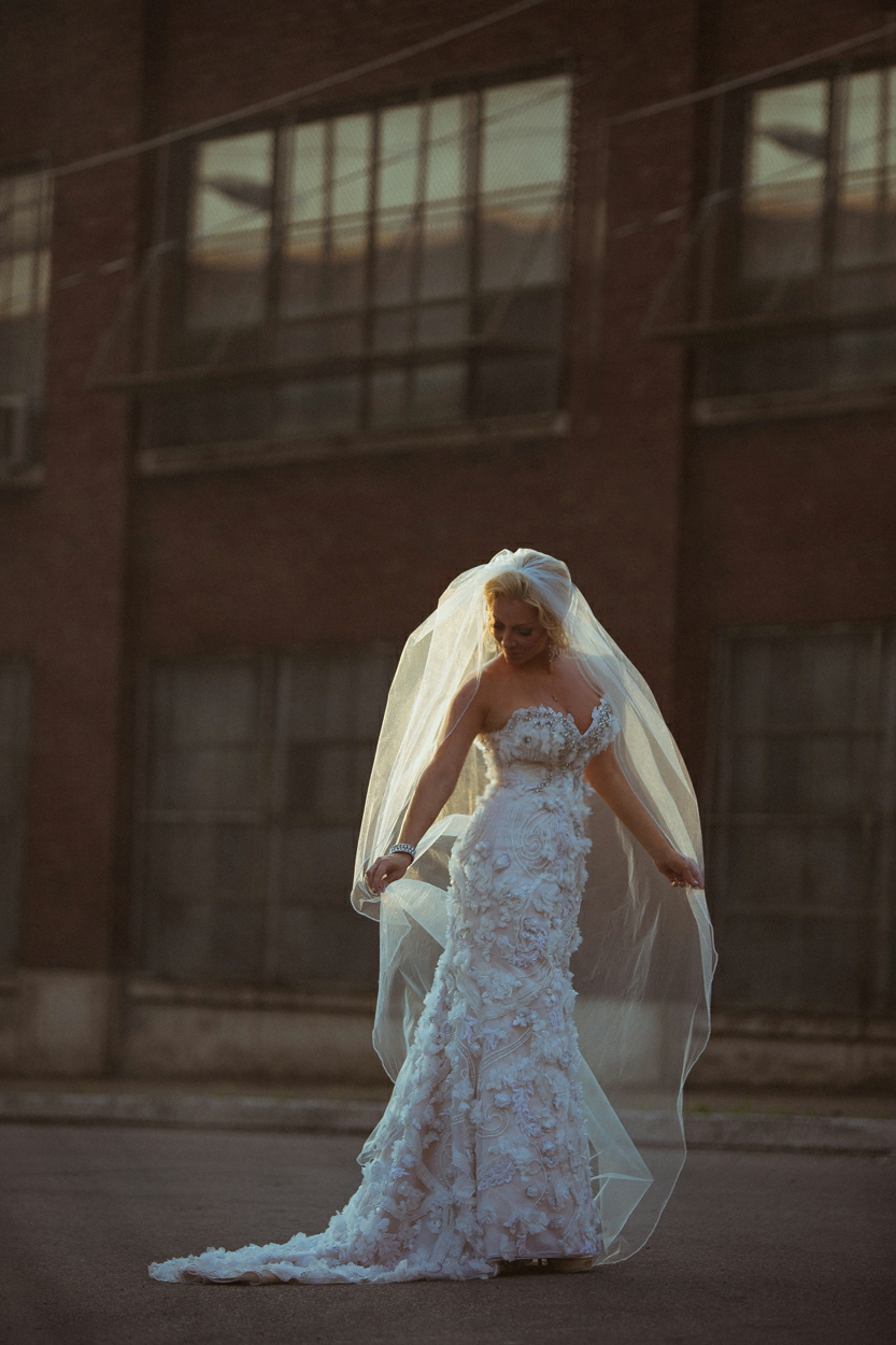 bride with veil in sunset