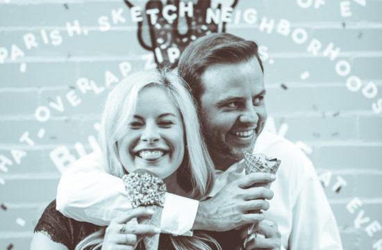 engaged couple eating ice cream laughing