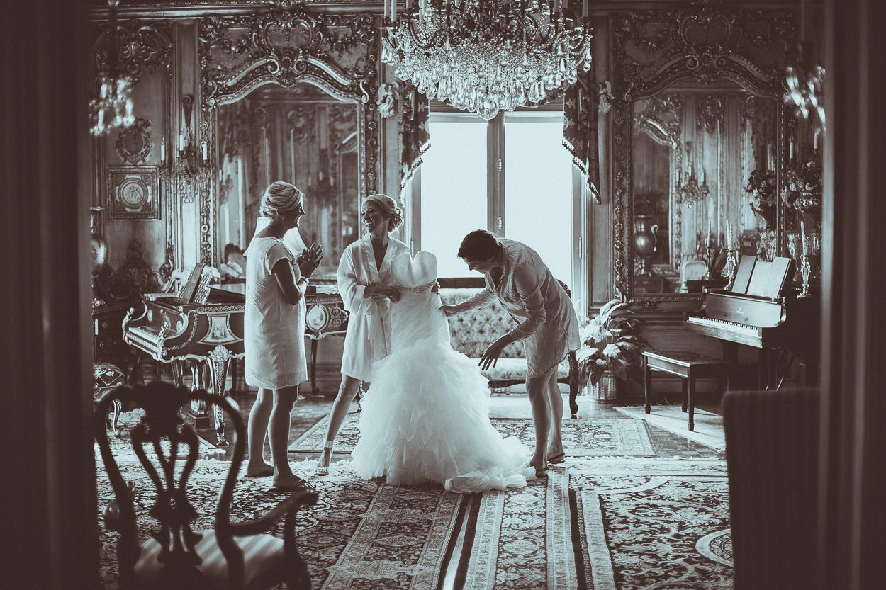 bride putting on dress at laurel court