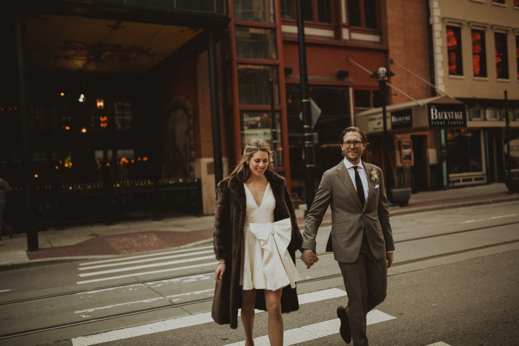 bride and groom walking in downtown cincinnati