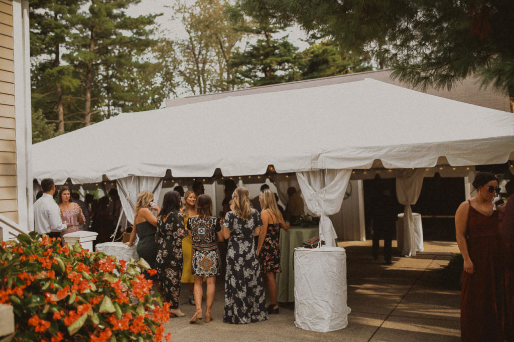 backyard wedding tent and guests