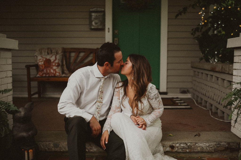 wedding couple kissing on porch