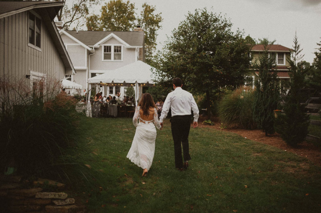 bride and groom in backyard