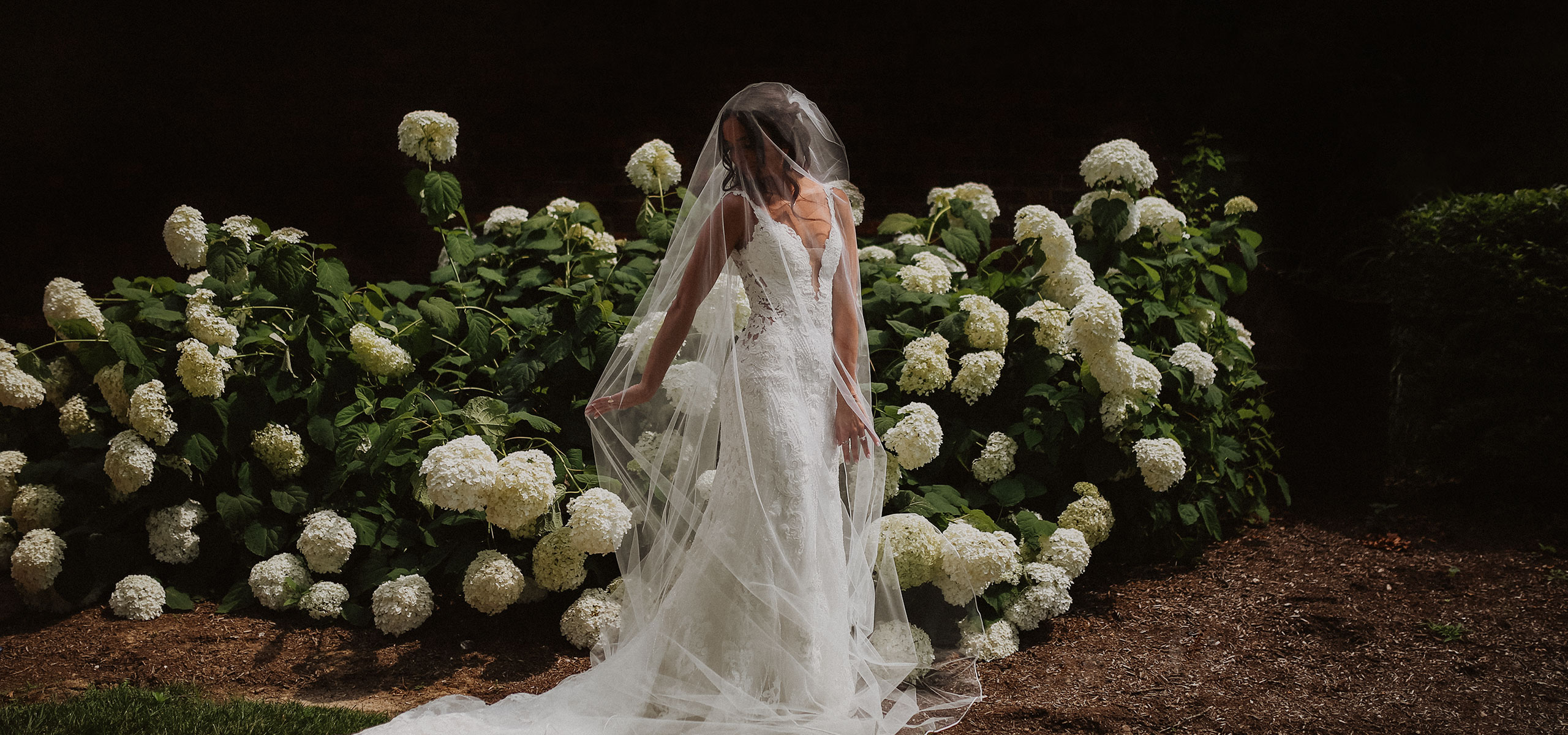 cincinnati pine croft bride in front of flowers
